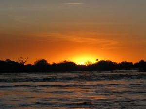 A sunset on the Zambezi river in Zambia.