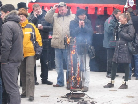Prague in December can be cold. My advice, have some mulled wine and camp out by this fire.