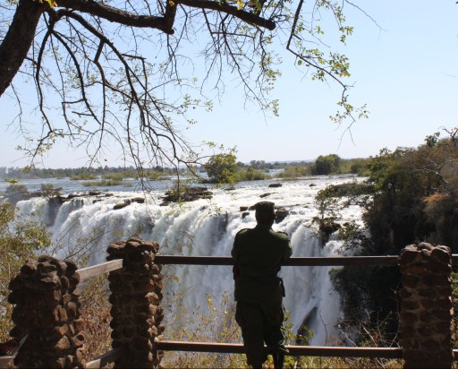 Do you think this guard ever tires of staring at Victoria Falls?