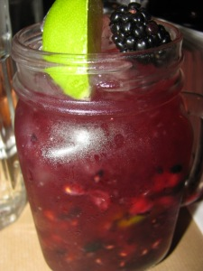 Vodka muddled with fresh lime, blackberries, and sugar. Yummy!