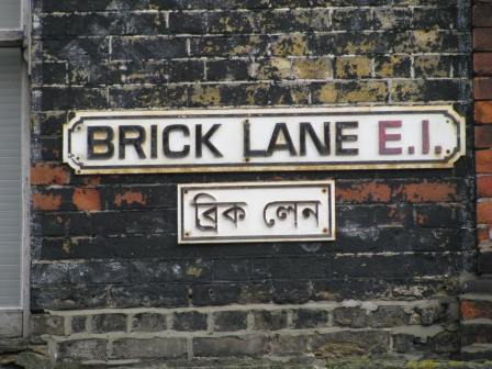 Underneath the sign you can see the street signs are written in Bengali.