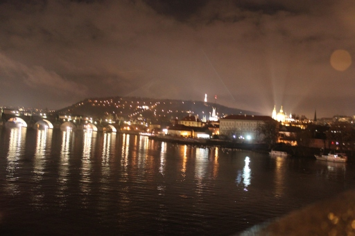 Prague at night. The bright spot on the right is Prague Castle.