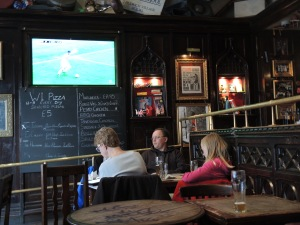 And to watch a few minutes of a football match on the telly. Photo taken in the Back Room Bar--the place I reviewed on Friday