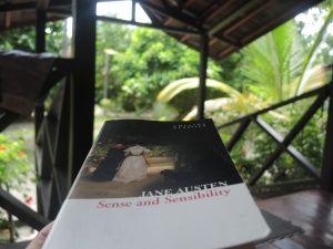In the early morning I sat on my private deck on Mabul Island to read.