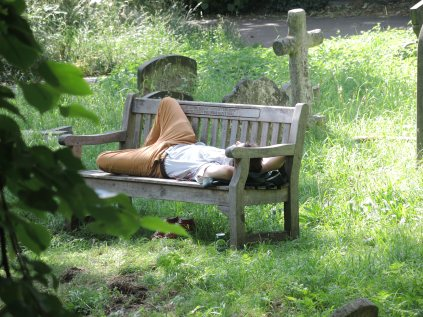 Man sleeping in Brompton Cemetery, London