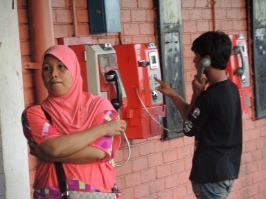 """He's always on the phone!"" Photo taken in Kota Kinabalu, Malaysia."