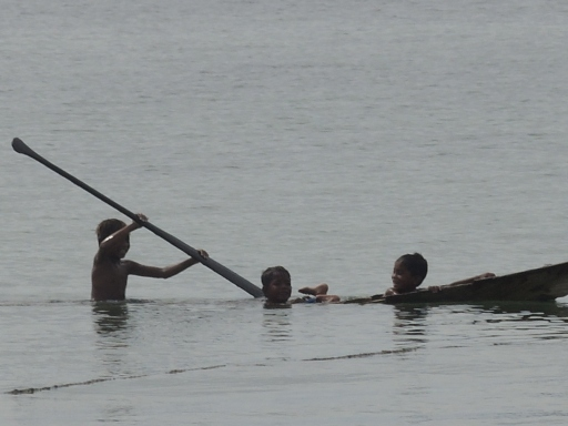 Even though their boat was sinking, they were still having a grand time. Photo taken on Mabul Island, Malaysia.