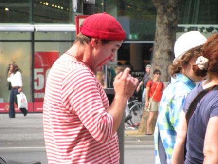 During our 2012 trip to Berlin we enjoyed watching this man torment other tourists. Most of the tourists didn't get mad. Some did, which was even funnier. Photo taken in Berlin, Germany.